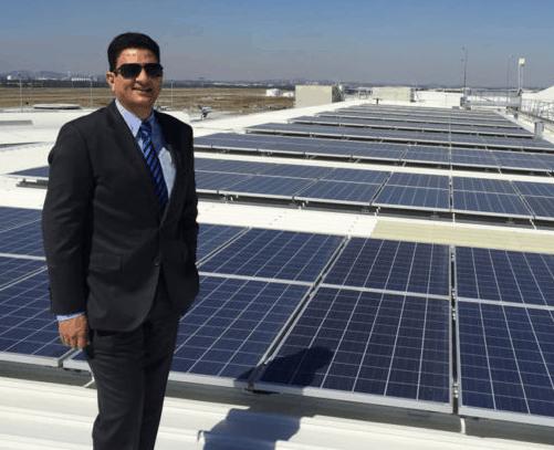 GM of BNE, Krishan Tangri, at the Brisbane Airport Solar array.